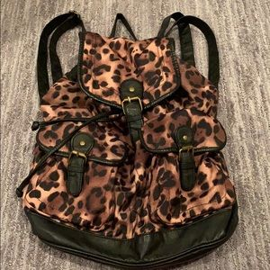 Leopard and leather backpack